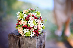 Beautiful wedding bouquet with red flowers Stock Photos