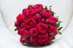 Beautiful wedding bouquet of red roses. Stock Photos