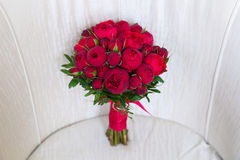 Beautiful wedding bouquet of red roses. Royalty Free Stock Photo