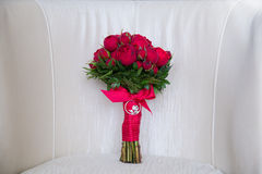 Beautiful wedding bouquet of red roses. Royalty Free Stock Image