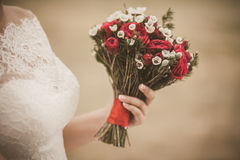 Beautiful wedding bouquet of red roses flowers in hand of anonym Royalty Free Stock Photography