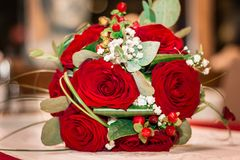 Wedding bouquet. Beautiful wedding bouquet with red roses. Greeting card for 8 March International Women`s Day. Close up Royalty Free Stock Photography