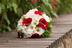 Beautiful wedding bouquet. Of red roses and white flowers Royalty Free Stock Image