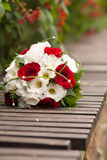 Beautiful wedding bouquet. Of red roses and white flowers Stock Photo