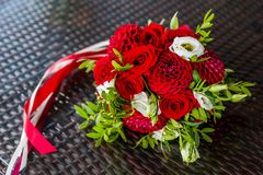 Beautiful wedding bouquet of red on the table of the abstract structure. Wedding flowers Stock Images