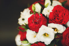Beautiful wedding bouquet of red and white roses, selective focus Stock Photos