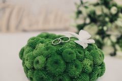 Wedding Bouquet With Rings Resting On Top. A beautiful wedding bouquet with rings resting on top royalty free stock image