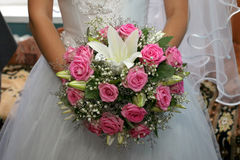 Beautiful wedding bouquet of roses in the bride's hands Royalty Free Stock Photo