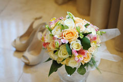 Beautiful wedding bouquet of roses and peonies on the pavement. Royalty Free Stock Image