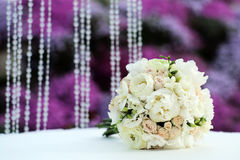 Beautiful wedding bouquet of roses and peony Stock Photos