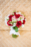 Beautiful wedding bouquet stands on vintage colden chair. Stock Photos