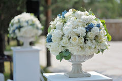 Beautiful wedding bouquet in stone vase closeup, outdoors Royalty Free Stock Images