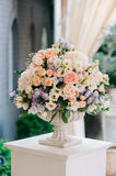Beautiful wedding bouquet in stone vase, closeup Stock Photos