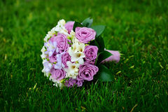 Beautiful wedding bouquet t lie on the grass Stock Image