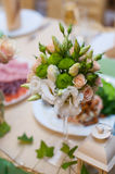 Beautiful wedding bouquet on a table of white and beige roses.  Royalty Free Stock Images