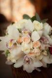 Beautiful wedding bouquet of white flowers. Lying on a dark windowsill Stock Photography