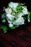 Beautiful wedding bouquet with white flowers and roses Stock Photos