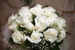 Beautiful wedding bouquet of white roses Royalty Free Stock Photography