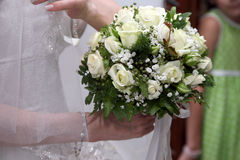 Beautiful wedding bouquet of white roses in the bride's hand Royalty Free Stock Image