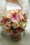 Beautiful wedding bouquet of white roses in the bride's hand Stock Images