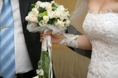 Beautiful wedding bouquet of white roses in the bride's hand Stock Photo