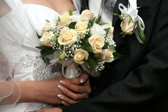 Beautiful wedding bouquet of white roses in the bride's hand Stock Image