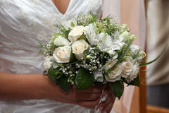 Beautiful wedding bouquet of white roses in the bride's hand Stock Photos