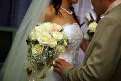 Beautiful wedding bouquet of white roses in the bride's hand Royalty Free Stock Photo