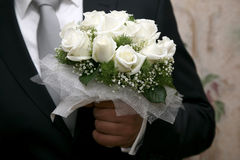 Beautiful wedding bouquet of white roses in hand of bride Stock Photography
