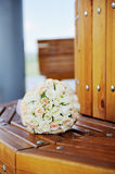 Beautiful wedding bouquet of white roses lying on a bench Stock Images