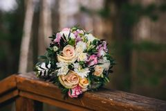 Beautiful wedding bouquet with yellow roses, white chrysanthemums and pink Alstroemeria Royalty Free Stock Photos