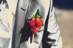 Beautiful wedding boutonniere at groom's costume Royalty Free Stock Photo