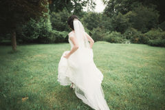 Beautiful wedding bride running in the garden Royalty Free Stock Photography