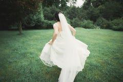 Beautiful wedding bride running in the garden Stock Images