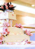 Beautiful wedding cake. A classic tiered wedding cake adorned with roses Royalty Free Stock Photography