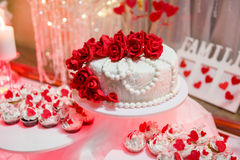 Beautiful wedding cake and cupcakes Stock Photo