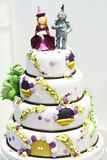 Beautiful Wedding cake decorated with knight and princess for pa Royalty Free Stock Photo