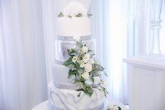 Beautiful Wedding Cake Decorated With Flowers. Silver And White Color Royalty Free Stock Images