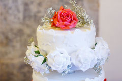 Beautiful wedding cake in different colors with two different le Royalty Free Stock Photography