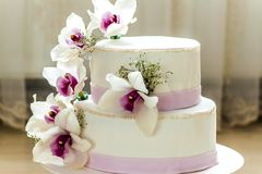 Beautiful wedding cake with flowers, close up of cake with blurr. Ed background, selective focus Stock Photo