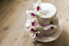 Beautiful wedding cake with flowers, close up of cake with blurr. Ed background, selective focus Royalty Free Stock Photography