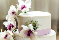 Beautiful wedding cake with flowers, close up of cake with blurr. Ed background, selective focus Stock Photos