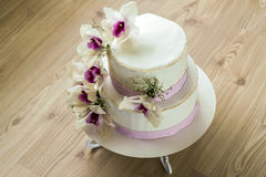 Beautiful wedding cake with flowers, close up of cake with blurr Stock Photography
