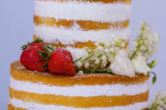 Beautiful wedding cake with strawberries close-up Royalty Free Stock Photography