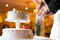 Beautiful wedding cake about to be cut stock image