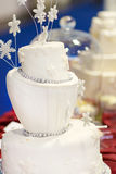 Beautiful wedding cake in white with snowflokes . Beautiful wedding cake in white with snowflokes Stock Photos