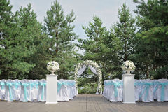 Beautiful wedding ceremony decorated with arch, flowers and chairs. Beautiful wedding ceremony design decoration elements with arch, floral design, flowers and Stock Photography