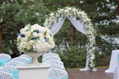 Beautiful wedding ceremony decorated with arch, flowers and chairs. Beautiful wedding ceremony design decoration elements with arch, floral design, flowers and Royalty Free Stock Photography