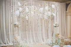 Beautiful wedding ceremony design decoration elements. With arch, floral design, flowers, chairs indoor Stock Photography