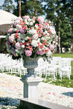 Beautiful wedding ceremony design decoration elements with fresh flowers composition, floral design, petals roses and Royalty Free Stock Photo